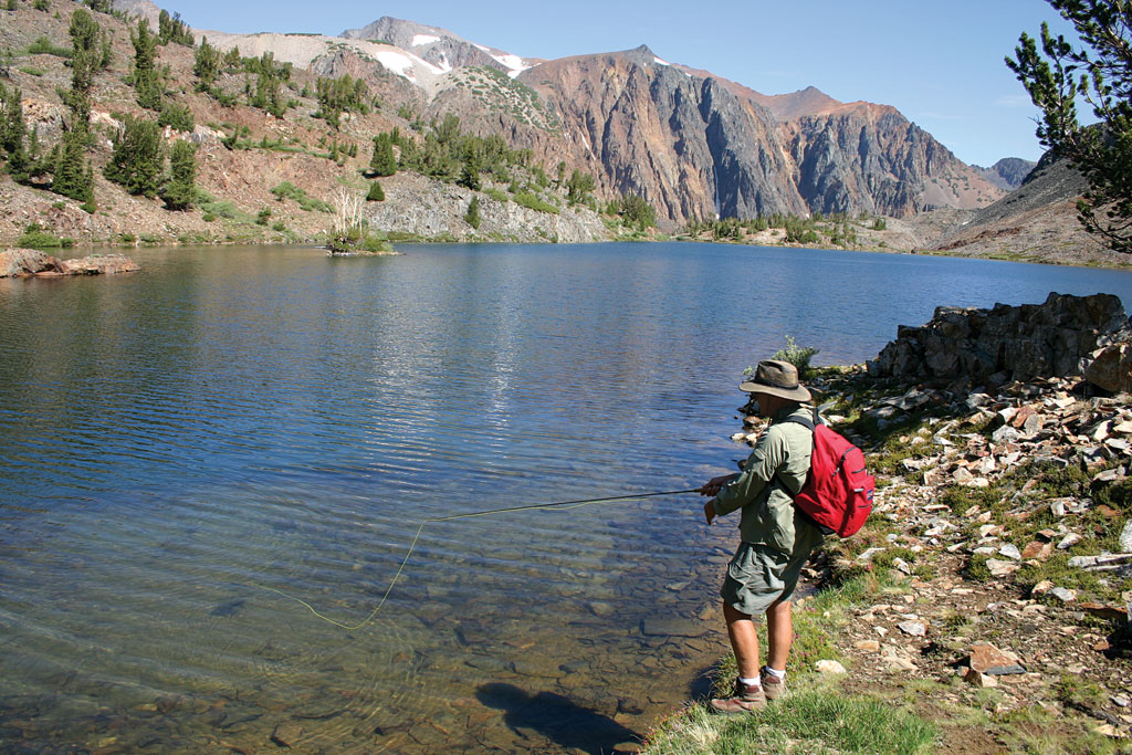 Approaching a remote trio of headwater lakes nestled near massive Conness Glacier, my son, Jason,