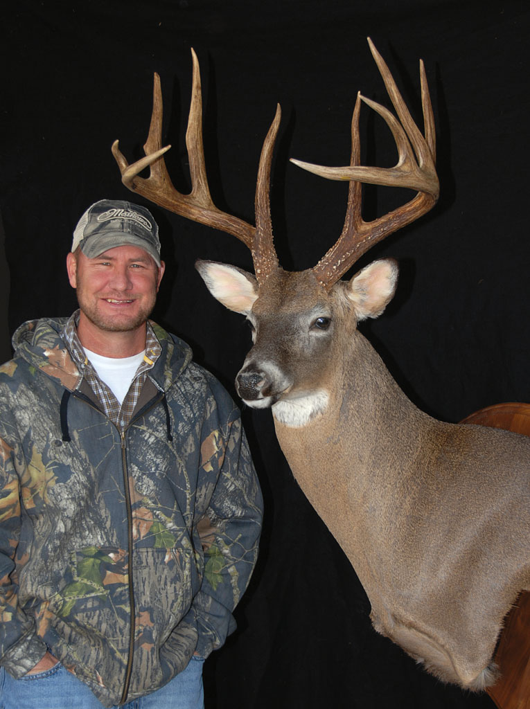 In early December of 2010, Mike Holland climbed into his Brooks County deer stand for a late