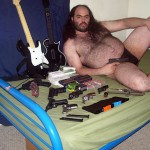 fat_hairy_guy_on_bed_with_guns