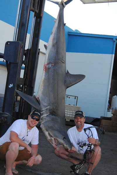 Patrick Eger, right, with his 544-pound world record mako. Photo courtesy of Wausau Daily Herald.