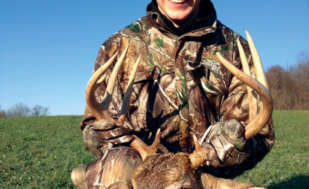 Gavin Collins displays his first buck, that he killed in Washington County, during the 2012 season.