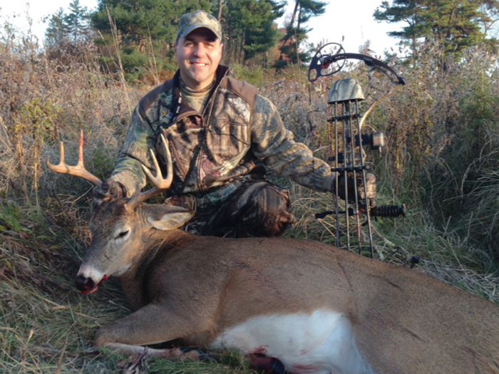 Joseph Hall of Lunenburg Mass. poses with the nice, eight point buck he killed during the 2013 archer season.