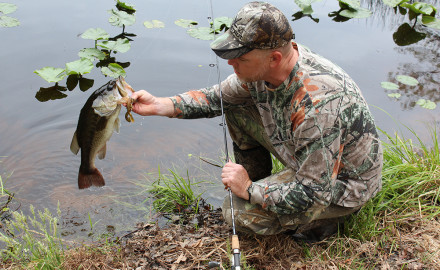 Author Mark Fike demonstrates that April is a great time to hit a pond after a morning of turkey hunting to catch big bass on creature baits.