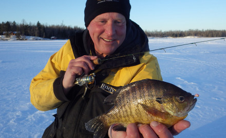 December's early ice fishing produces good bluegill fishing on many lakes in the Grand Rapids area.