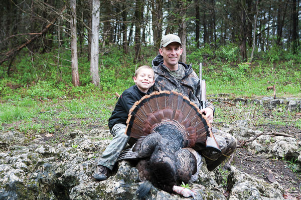 Nicholas Jeffries and his dad, Aaron Jeffries, of Jefferson City, enjoy Missouri's youth turkey season.