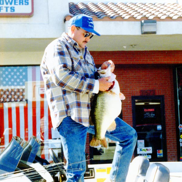 Robert Crupi and his lunker 22 lb lunker largemouth pictured here getting ready for an official weigh- in.