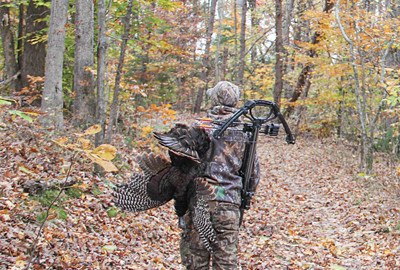 The author's son shows what fall turkey hunting success looks like. An advantage to a crossbow is