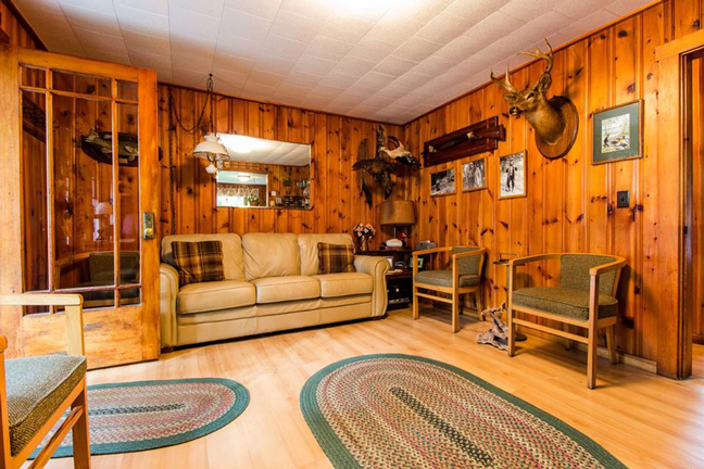 The warm lobby at Wheaton's Lodge is typical of the rustic-yet-comfortable accommodations awaiting fishermen heading to Maine. Photo Courtesy Wheaton's Lodge