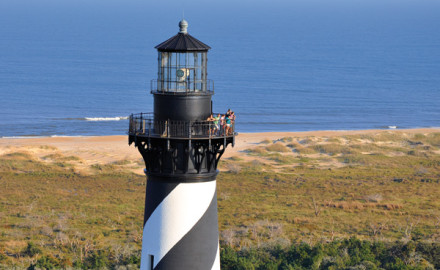 The iconic lighthouse at Cape Hatteras is just one of the many exciting places to visit on the Outer Banks, where the fishing is legendary. Photo Courtesy Outer Banks Visitors Bureau