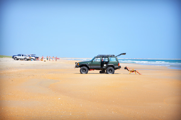 With a permit, you can still take a 4-wheel-drive vehicle onto certain beaches on the Outer Banks to fish or just enjoy the sun. Photo Courtesy Outer Banks Visitors Bureau