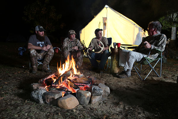 Camaraderie and sharing good times around the fire with friends and family is one of the most enjoyable aspects of hunting. Credit: Photo by Ron Sinfelt