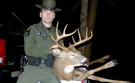 New York ECO Zachary Crain with an illegally killed 10-point buck reportedly shot over bait.