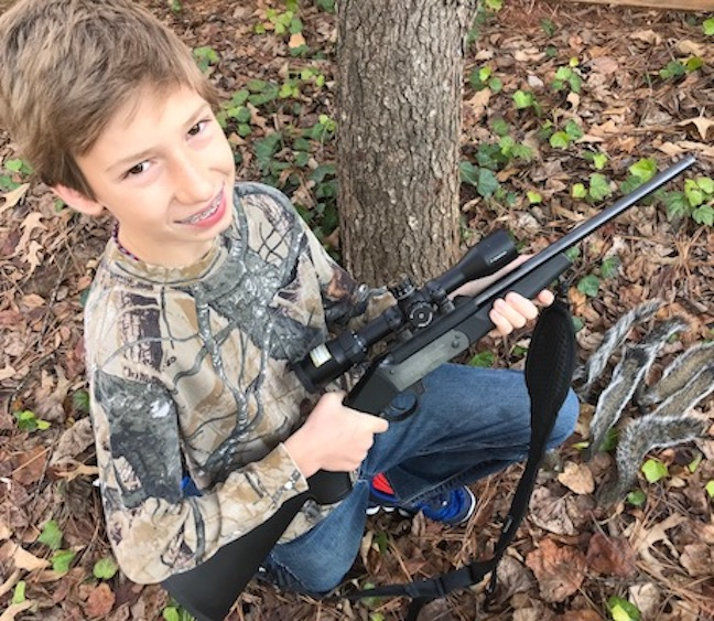 """""""I love that rifle, Dad. It's mine, right?"""" (Photo by John Geiger)"""