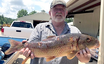 Missouri angler Rick Sartin is shown with his state-record silver redhorse. (Photo courtesy of