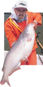 Catfish-Hold-Rainsuit-In-Fisherman