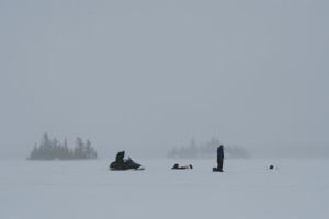 Desolate-Lake-Ice-Fishing-In-Fisherman