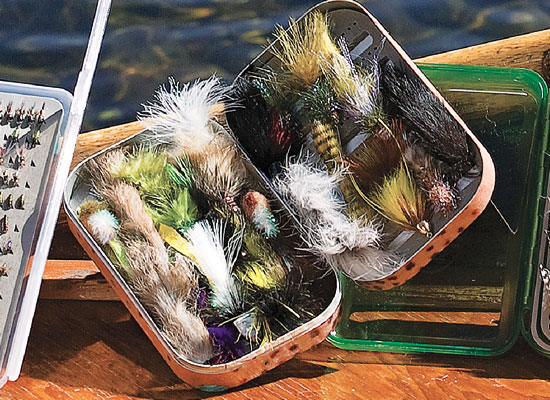 The Aluminum River Camo Box is available in regular camo, river rock, brown trout, and rainbow trout designs. This box is crammed with MFC streamers.
