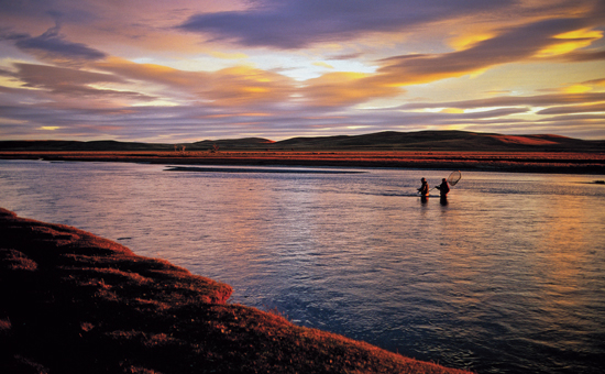 Brown trout are most active in the low light of early morning and late evening, and these are the magic hours on the fabled waters of the Rio Grande  in Argentina's Tierra del Fuego. R. Valentine Atkinson photo