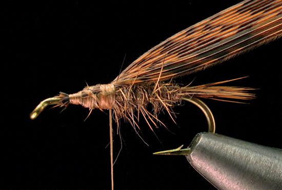 tying flies fly fisherman