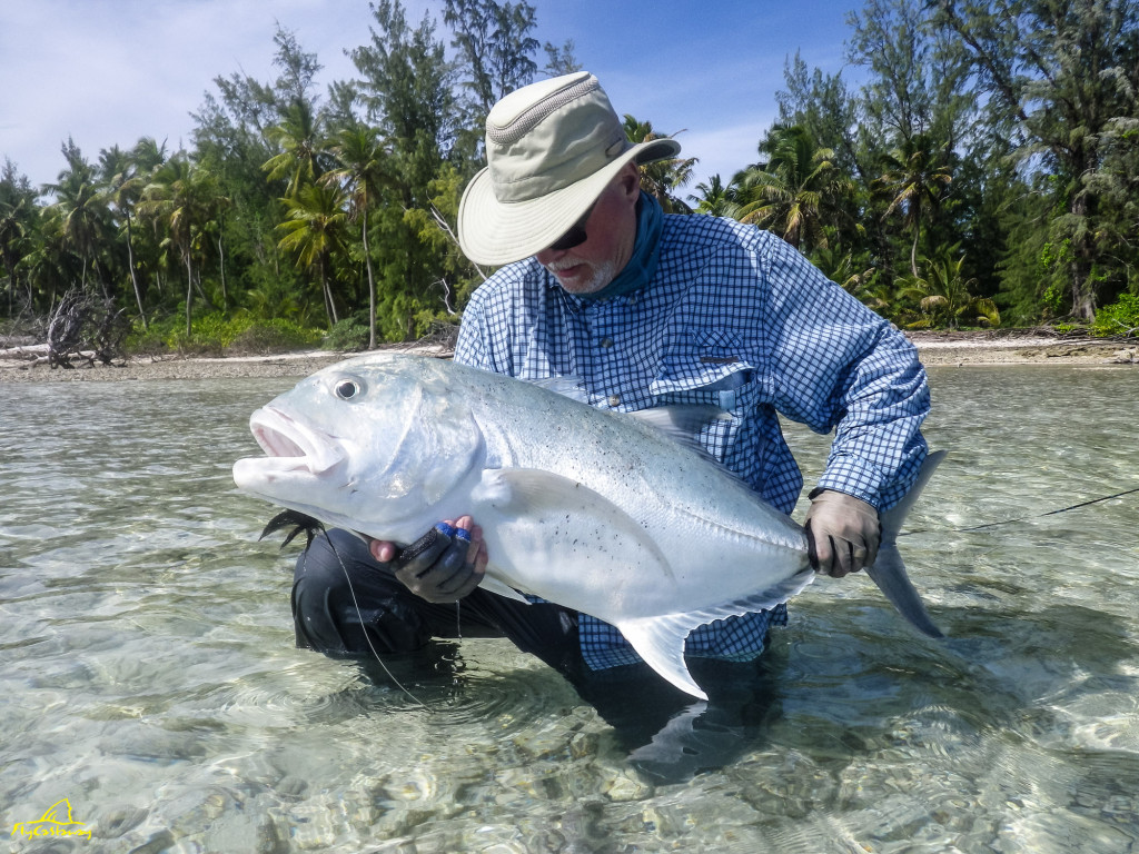 Doug McLean with a Farquhar giant trevally in December 2015.