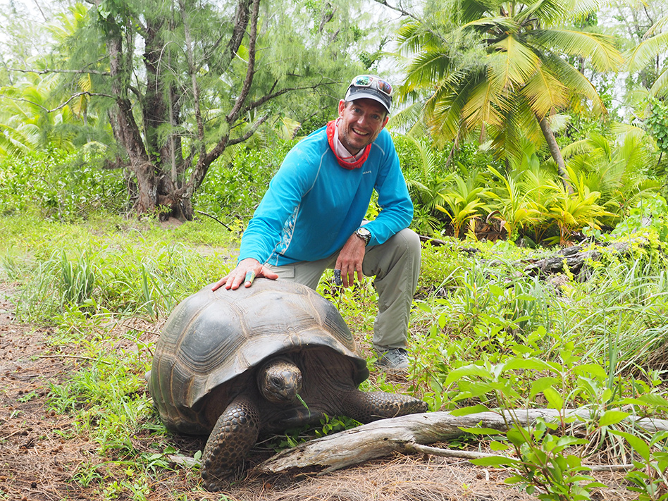 Ross Purnell with a giant Seychelles tortoise in the forests of Farquhar December 2015.
