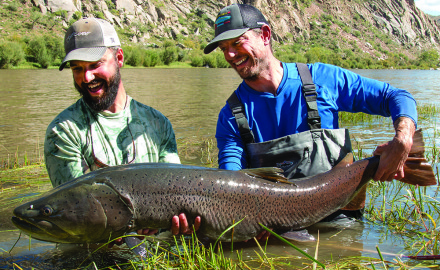 Guide Jeff Forsee and Fly Fisherman editor Ross Purnell with a 55-inch taimen from the Delger River.