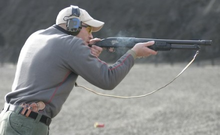 Shooting a Mossberg 500 from the fighting stance.