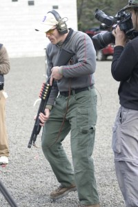 George Wehby from PDTV in the low ready position with a Mossberg 590A1 shotgun.