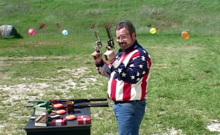 Trick shooter Bill Oglesby demonstrates ambidextrous shooting -- offhand revolver shooting with 4