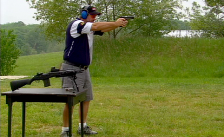 Pro shooter Rob Leatham demonstrates proper stance when shooting a rifle or a handgun.