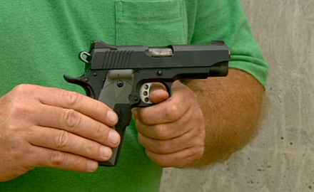 Assistant Editor Richard Venola shows off the Kimber Pro TLE (Tactical Law Enforcement) compact