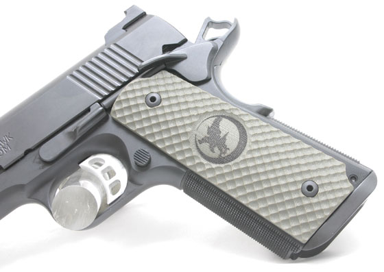 Both the Falcon and the GRP Recon have Nighthawk's positively gripping golf ball dimple grip texture. This pistol is going nowhere during recoil or if you're bloodied during a fight.