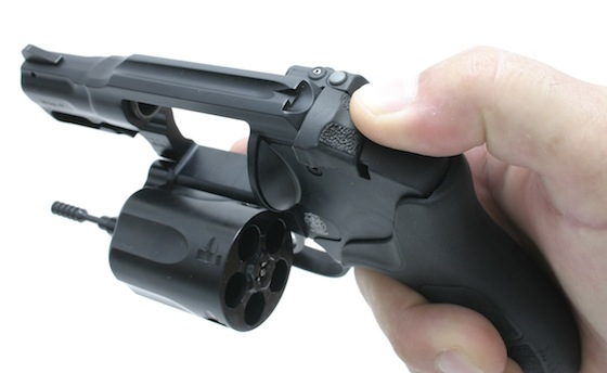 Smith & Wesson moved the latch to the top of the frame where you would expect a hammer spur.