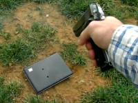 Father shoots laptop