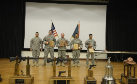 (L to R holding awards) Staff Sgt. Leif Devemark, Sgt. 1st Class Sean Bayard, Sgt. Demetrios
