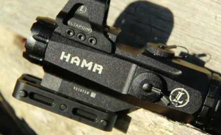 Kyle Lamb shows off the HAMR, a 4X fixed scope by Leupold.