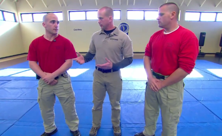 Jason Teage and law enforcement experts demonstrate the proper way to handle yourself if a handgun