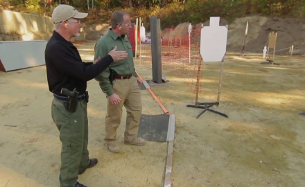 Tom Beckstrand takes Gerry Tetrean's advice to heart as he tries his best to keep up with Gerry as he runs a course of fire at the SIG Sauer Academy.
