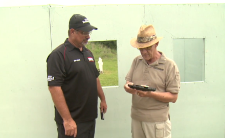 Dick Metcalf and Rob Leatham go over the finer points of the Springfield XDm 5.25 competition