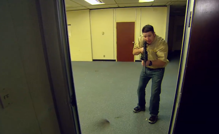 Richard Nance demonstrates tactics for clearing a building with an AR platform rifle.