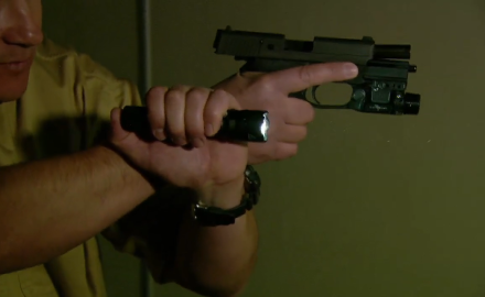 Richard Nance demonstrates the proper way to operate a handgun with a flashlight while working his way through a darkened environment.