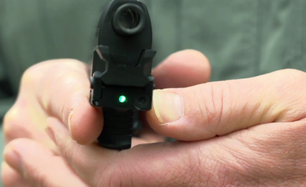Kyle Lamb and Richard Nance examine the compact Micro Tac laser from TruGlo.