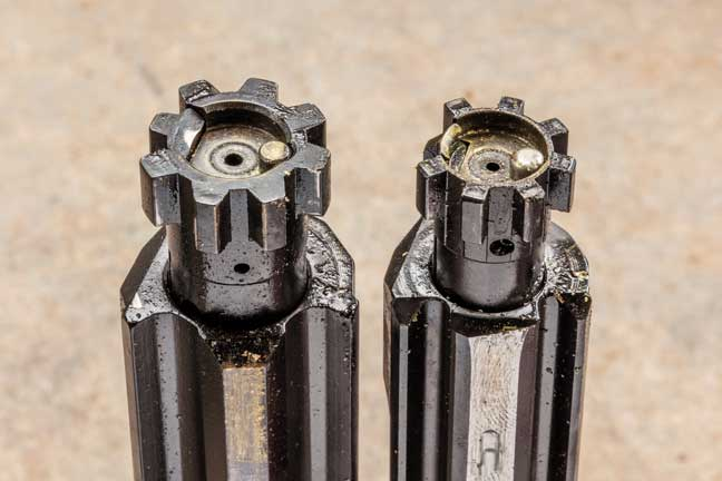 The CMMG bolt (left) scores with beefier lugs on either side of the extractor.