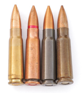 Caliber 7.62x39mm cartridge cases are principally of three types, left to right: brass, copper-washed steel and lacquered steel in varying shades of gray, OD or brown lacquer.