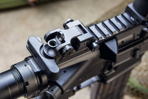 """The Samson Mfg. flip-up rear sight co-witnesses with the """"F"""" marked front sight post and provides ½-MOA- per-click windage adjustments. A stainless steel clamp adds security for a rifle that can get knocked around."""