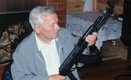 Mikhail Kalashnikov sits in his home discussing his design with the author. A hero in his own country, his rifle is known and respected around the globe.