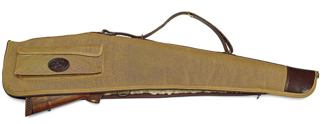 Galco's Field Grade Scoped Rifle/Shotgun Case is constructed of khaki cotton duck, lined with acrylic fleece and trimmed with rich Havana leather. The hardware is solid brass, and the carry handle/shoulder strap is adjustable. Its external pouch can carry two boxes of ammo. $135