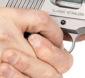 How hard should you grip your pistol?