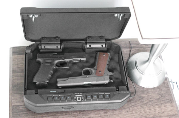 The author's Glock 17 and Government-sized 1911 easily fit in the safe with room to spare for an additional magazine for each.
