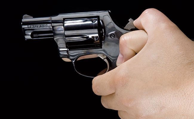 When you cock the revolver with your left hand, you can maintain your shooting grip.
